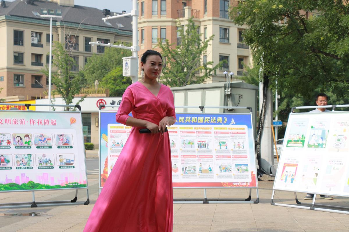 省文化和旅游厅组织党员进社区开展暖绿城志愿服务活动